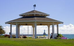 Gazebo and Lighthouse. A large Gazebo with a view of Lake Michigan and the lighthouse at Port Washington, Wisconsin Royalty Free Stock Photos