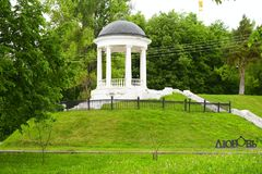 The gazebo is made of seven columns and a roof, such structures were garden gazebos. Беседка Островского. Ostrovsky gazebo is one of the symbols of Kostroma. It is located on the banks of the Volga river, on a high mound, which remained from the ancient Kremlin shafts, and from here opens one of the most luxurious views of the river. The gazebo is made of seven columns and a roof, such structures were garden gazebos in old Russian estates stock photos
