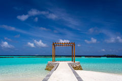 Gazebo made of wood at Maldives. In front of Indian ocean Stock Photo