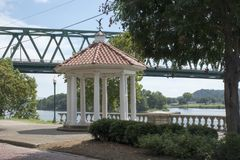 Gazebo at Marietta Ohio Levee. A small gazebo in Marietta, Ohio that overlooks the levee and the Ohio River. The bridge in the background connects Marietta with royalty free stock images