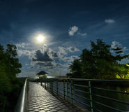 Gazebo and moon in water's reflection. Night landscape Royalty Free Stock Photography