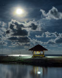 Gazebo and moon in water's reflection. Night landscape Stock Photo
