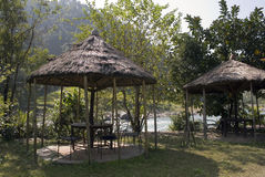 Gazebo near the River. River camp along the Bhote Koshi in Nepal Stock Photo
