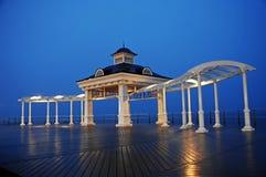 Gazebo near the sea. Nicely lit gazebo at dusk on a boardwalk Stock Photos