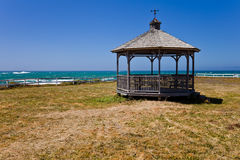 Gazebo on an ocean coast. Ocean coastline landscape with gazebo and fence Royalty Free Stock Images