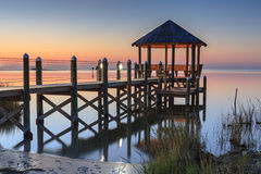 Gazebo over Pamlico Sound Hatteras, North Carolina. Landscape of a calm summer night with gazebo over the water of Pamlico Sound in Hatteras, North Carolina Royalty Free Stock Photos