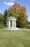 Gazebo and park benches in autumn Stock Photo