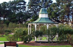 Gazebo in a park. Gazebo in a big sity park with a garden Royalty Free Stock Photo