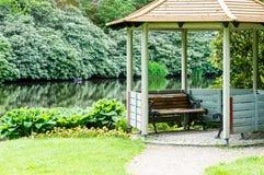 Gazebo in park. An open gazebo near a pond or lake in public park Royalty Free Stock Images
