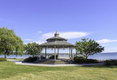 Gazebo on the shoreline of Canandaigua Lake. Gazebo in the park. Sunny day and calm water on the lake royalty free stock photo