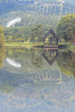 Gazebo pavilion near the lake. In orange farm Royalty Free Stock Photography
