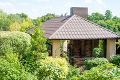 Gazebo with place for barbecue in a juicy green summer garden. The Gazebo with place for barbecue in a juicy green summer garden Stock Photos