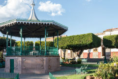Gazebo at a plaza in Quiroga Mexico. A gazebo at a plaza with  trees cut into square shapes in Quiroga, Michoacan, Mexico Stock Images