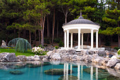 Gazebo by the pond. In a beautiful green park stock photos