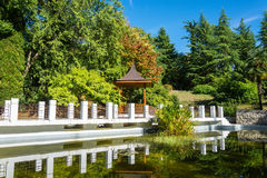 Gazebo and pond in the Park-the arboretum of Sochi. Beautiful gazebo and pond is framed by white stone in the Park-the arboretum of Sochi Royalty Free Stock Images