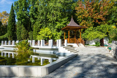 Gazebo and pond in the Park-the arboretum of Sochi. Beautiful gazebo and pond is framed by white stone in the Park-the arboretum of Sochi Royalty Free Stock Photos