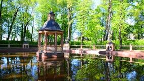 Gazebo by pond in summer park in St. Petersburg, Russia stock video