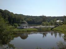 Gazebo on the pond. Pond. gazebo on the pond. trees around royalty free stock photo