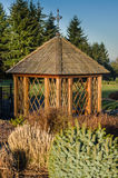 Gazebo in a public garden. Gazebo in a landscaped garden with shrubs Stock Photo