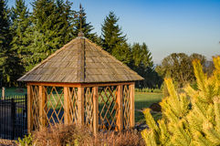 Gazebo in a public garden. Gazebo in a landscaped garden with shrubs Stock Photography