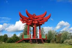 Gazebo, red pagoda. Gazebo. Red Pagoda. green grass and blue sky Stock Photography