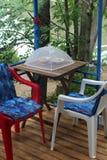 Gazebo on river bank. Table under gazebo in garden on river bank Stock Image