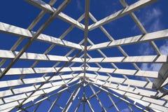 Gazebo Roof Frame. Wide open gazebo roof frame against blue sky stock images