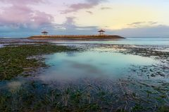 Gazebo in sanur beach during sunset. Gazebo in the middle on sea in low tide during sunset or sunrise royalty free stock photos