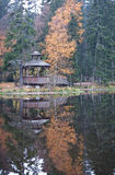 Gazebo on the shore of the lake at autumn Stock Image