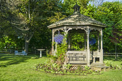 Gazebo with Spring Flowers Stock Photos