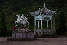 Gazebo and Statue of a General with flower