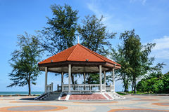 Gazebo sun shading. Octagonal shape gazebo along the samila beach shore Stock Photography