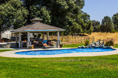 Gazebo & Swimming Pool On Ranch Royalty Free Stock Photography