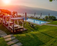 Gazebo to protect from the sun with a lake view. Gazebo with white sheets to protect yourself from the sun stock images