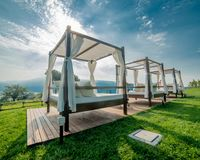 Gazebo to protect from the sun with a lake view. Gazebo with white sheets to protect yourself from the sun stock photo