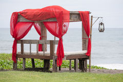 Gazebo on the tropical beach . The island of Bali, Sanur, Indonesia. Recreation area on the tropical beach. The island of Bali, Sanur, Indonesia Stock Photo