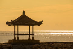 Gazebo on the tropical beach during sunrise. Stock Photos