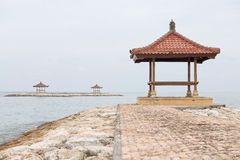 Gazebo on the tropical beach during sunrise. The island of Bali, Sanur, Indonesia Royalty Free Stock Images