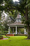 Gazebo under the trees. Gazebo photo in the summer with a tree framing the shot Royalty Free Stock Photography
