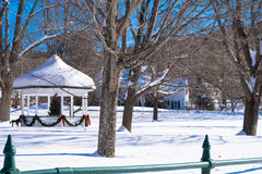 Gazebo in village winter holiday scene Stock Photography