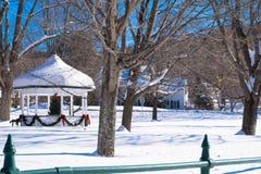 Gazebo in village winter holiday scene Stock Photography
