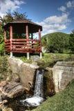 Gazebo waterfall. And background mountain Stock Photography