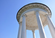 Gazebo with white columns against the sky Stock Photography
