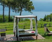 Gazebo to protect from the sun with a lake view. Gazebo with white sheets to protect yourself from the sun stock image