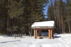 Gazebo in the winter woods Stock Image
