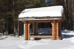 Gazebo in the winter woods Stock Images