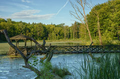 Gazebo. Wooden gazebo on a pond in the middle of forest, Masuria, Poland Royalty Free Stock Photography