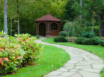 Gazebo in the woods. Gazebo in a forest in the landscape design Royalty Free Stock Photography
