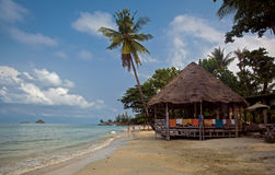 Gazebos, palm trees, clouds in the South-East Asia Royalty Free Stock Images