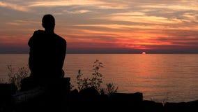 Gazing на заходе солнца стоковое фото rf